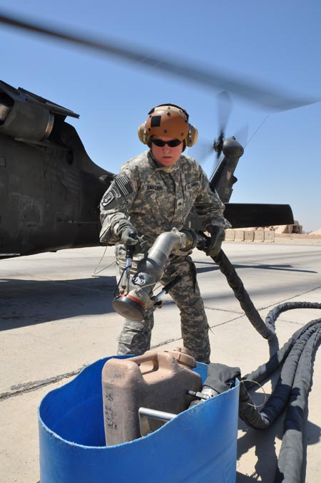 Oregon National Guard Sgt. Robin Sayler, Eugene, Ore., and an aircraft refueler attached to Company E, 1st Battalion, 137th Assault Helicopter Battalion of the Ohio National Guard, replaces a hose after refueling a UH-60 Black Hawk helicopter on Monday, August 24, 2009. U.S. Army photo by Staff Sgt. Jeff Lowry, Task Force 38 Public Affairs