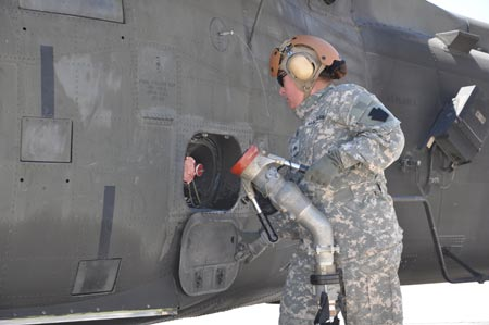 Oregon National Guard Sgt. Robin Saylor, Eugene, Ore., and an aircraft refueler attached to Company E, 1st Battalion, 137th Assault Helicopter Battalion of the Ohio National Guard, finishes fueling a UH-60 Black Hawk helicopter on Monday, August 24, 2009. U.S. Army photo by Staff Sgt. Jeff Lowry, Task Force 38 Public Affairs