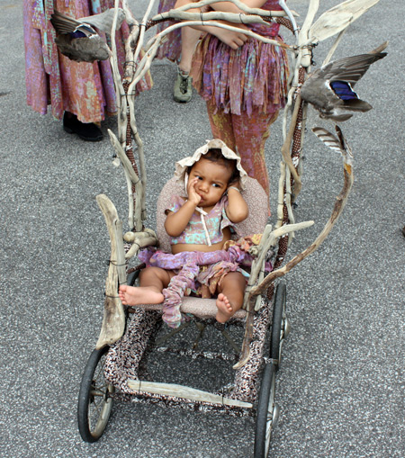 Baby in wood stroller