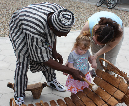 Little girl tries the balafon
