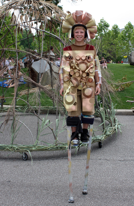Boy on stilts at Parade the Circle in University Circle