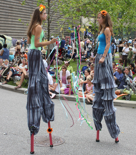 Girls on stilts at Parade the Circle in University Circle