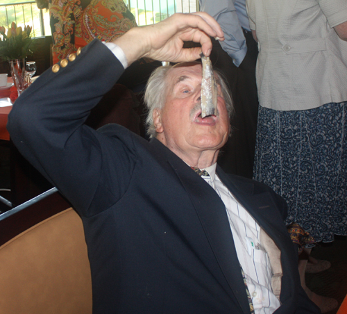 Dutch man eating herring