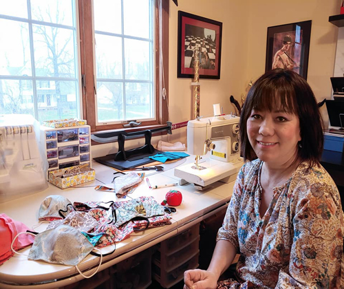 Oanh Loi-Powell at her sewing machine