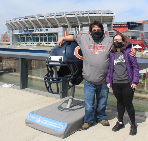 Fans posing with the Chicago Bears helmet