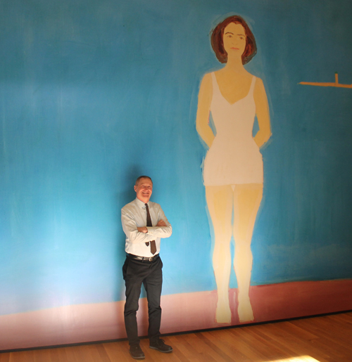 Curator Mark Cole in front of an image of The Bather