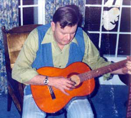 Norm Hanson playing guitar