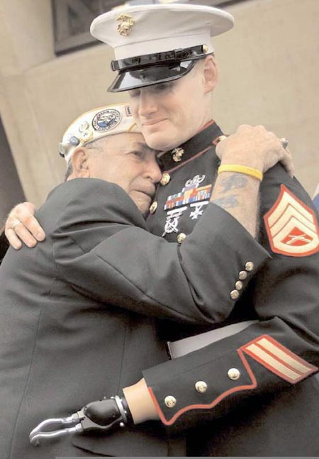 Old soldier hugs wounded young soldier