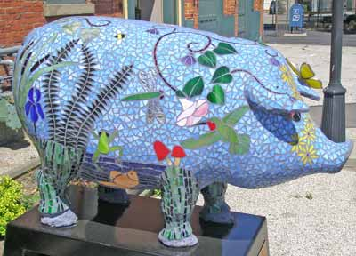 Sowing the Seeds of Peace and Love Pig Sculpture at 1588 East 40th
