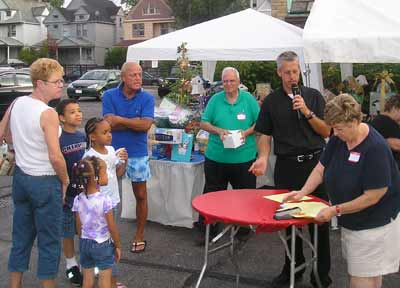 Father Chris Weber announcing raffle winners at the St Philomena rib off