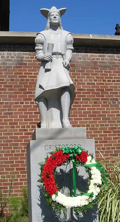 statue of Christopher Columbus with wreath