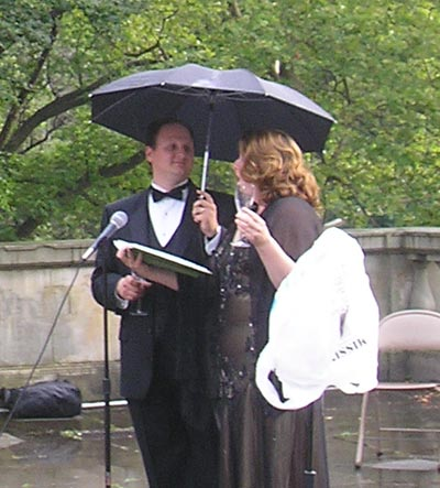 Timothy Culver and Andrea Chenoweth under the umbrella