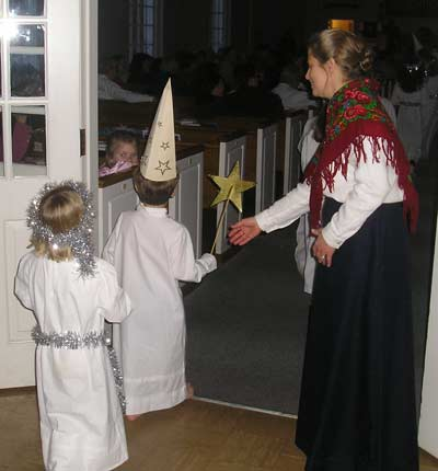 Santa Lucia procession - young children marching