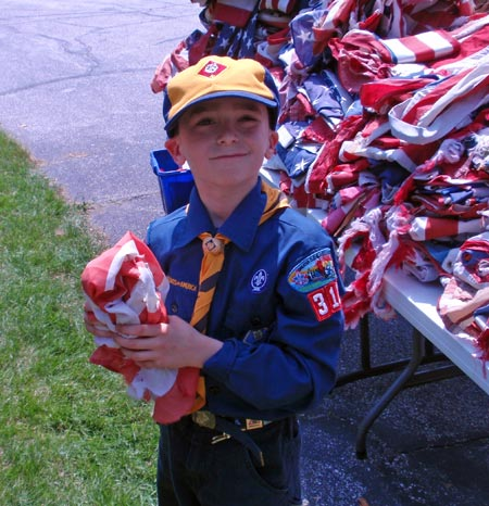 Cub scout with flag