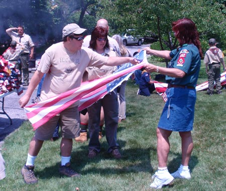 Scouts cut the US flag for proper retirement