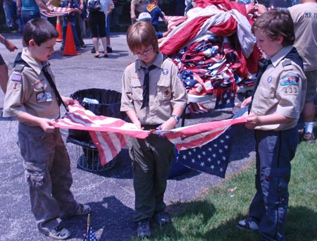Boy Scouts cutting US flag for retirement