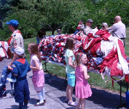 Some of the large quantity of US flags collected to be respectfully retired on Flag Day