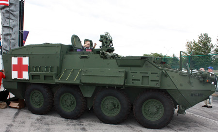 Young boy driving tank