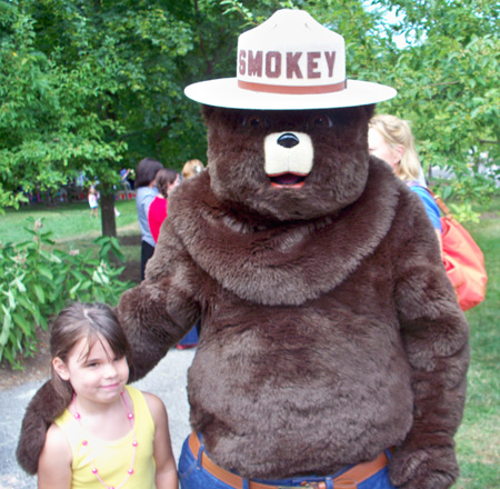 Smokey the Bear with little girl