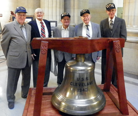 USS Cleveland crew with ship bell