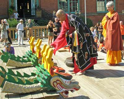 Buddhist Monk blessing the dragon boat dragon heads
