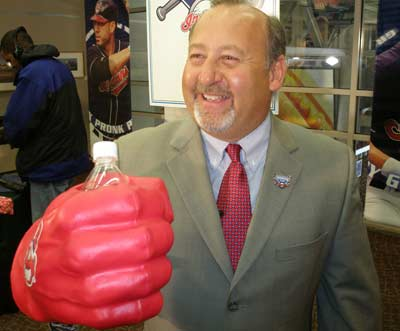 Cleveland Indians VP of Marketing Bob DiBiasio showing a new product - a large fist beverage holder
