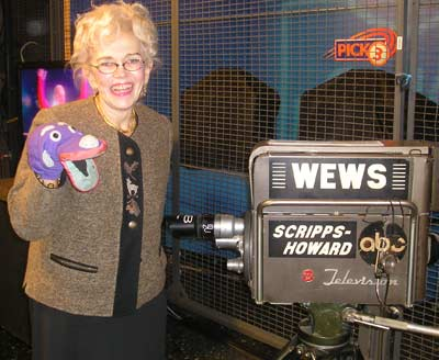 Ruth Sindelar with Dr. Buttons, the sock puppet her late husband Ernie Sindelar used on air.