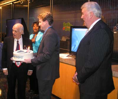 Weatherman Mark Johnson carried the cake during the singing of Happy Birthday