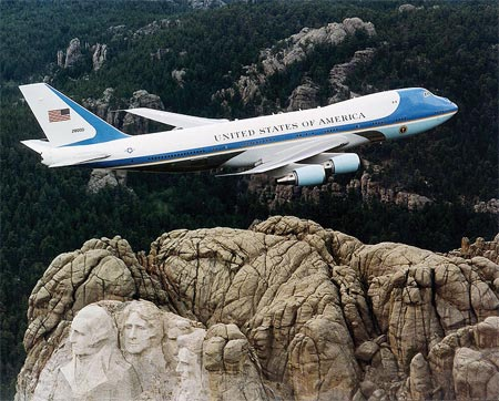 Mount Rushmore with Air Force One flying over