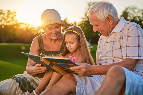 Grandparents reading to girl