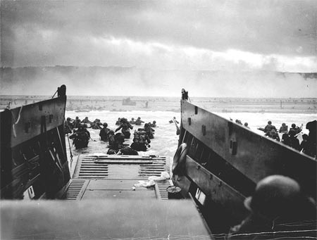 U.S. Army troops wade ashore on Omaha Beach during the landings, 6 June 1944