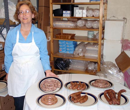 Sharon Jesse of Old World Meats shows different kinds of sausage