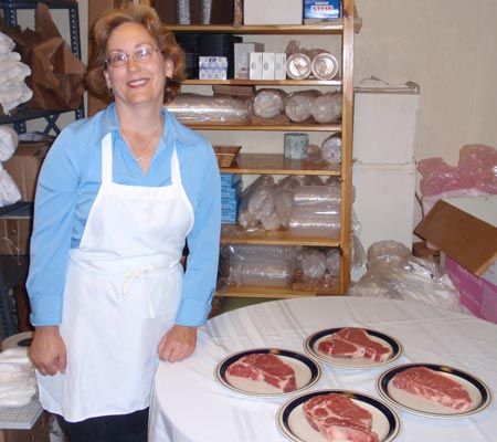 Sharon Jesse with steaks at Old World Meats
