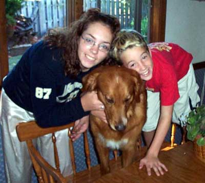 Golden Retriever Buddy with Miller family