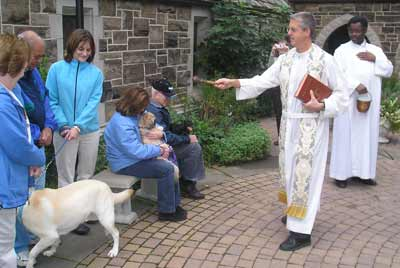 Father Chris blesses the pets