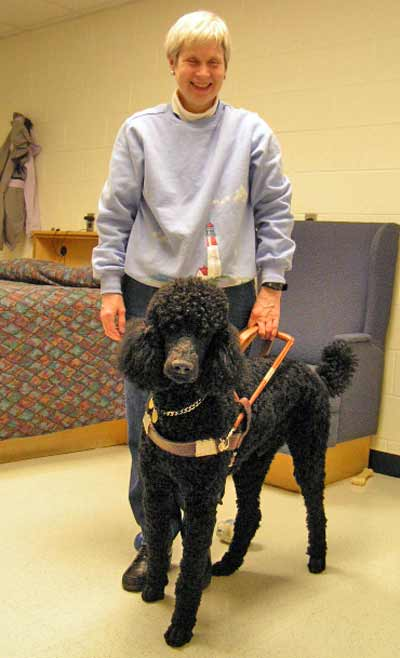 Pam Blizzard with her guide dog Nicholas the poodle