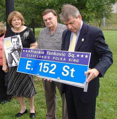 Cecilia Dolgan, president of the National Cleveland-Style Polka Hall of Fame with radio host and Hall of Fame Chairman Tony Petkovsek and Cleveland City Councilman Michael Polensek who initiated the process of naming Frank Yankovic Square