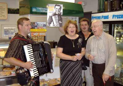 Accordionist Bob Kravos, Cecilia Dolgan, Bob Yankovic and some-time Yankovic vocalist Paul Yanchar lead a singalong at the reception at Raddell's Sausage Shop on Yankovic Square.