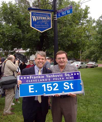 Cleveland councilman Mike Polensek and polka radio host Tony Petkovsek with the new Frankie Yankovic Square signs.