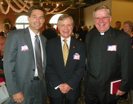 Matt Dolan, Dan Carter and Fr. Howard Humphrey