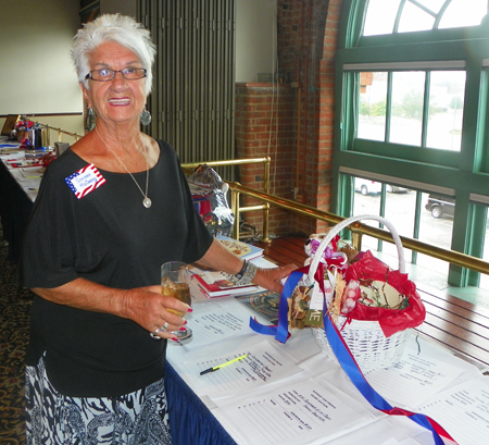 Sondra McCarhty checks out the Silent Auction