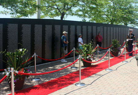Marine Honor Guard posted at the largest replica of the Vietnam Veterans Memorial Wall during Marine Week in Cleveland