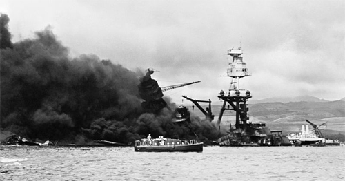 The burning wreckage of the U.S. Navy battleship USS Arizona (BB-39) at Pearl Harbor, Hawaii.
