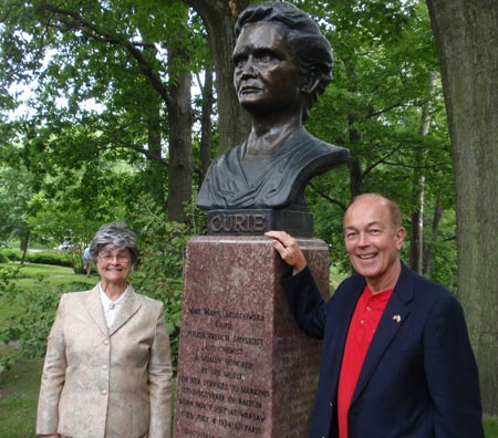 Judge Diane Karpinski and Ben Stefanski with the restored bust of Madame Marie Curie