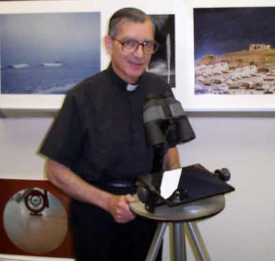 Father Emmanuel Carreira with one of his inventions