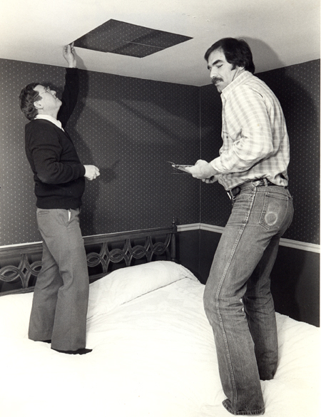Dan Coughlin and Doug Dieken removing mirrors from the ceiling