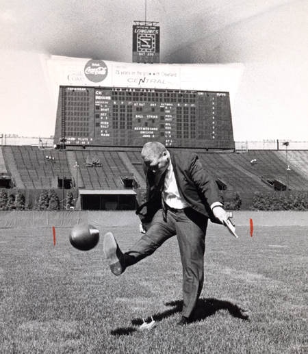 Dan Coughlin kicks football at Cleveland Municipal Stadium in 1965