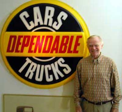Del Spitzer with car dealership sign
