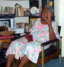 Fannie Lewis at home in chair