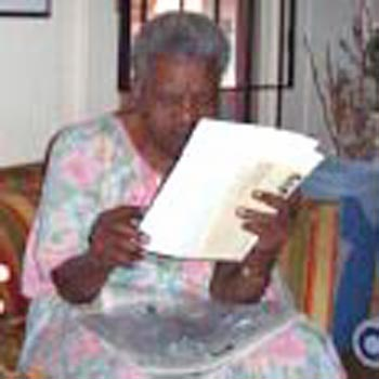 Fannie Lewis doing paperwork